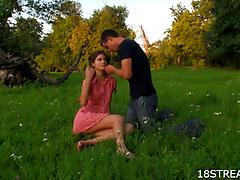 Really hot babe with dark hair gets nailed on the grass