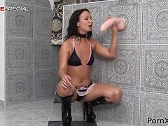 Skinny brunette babe in high heeld boots drills cunt with a big toy